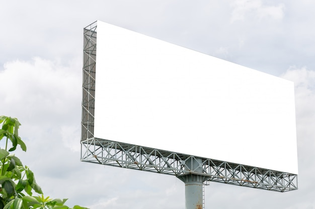 Mockup image of blank billboard white screen posters with white clouds sky for advertising