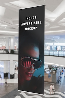 Mockup of indoor advertising vertical hanging flag in mall shop ping centre
