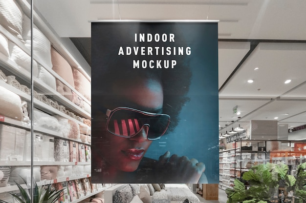 Mockup of indoor advertising vertical hanging poster in mall shop ping centre shop window