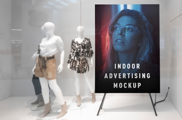 Mockup of indoor advertising vertical poster stand in mall shop ping centre shop window