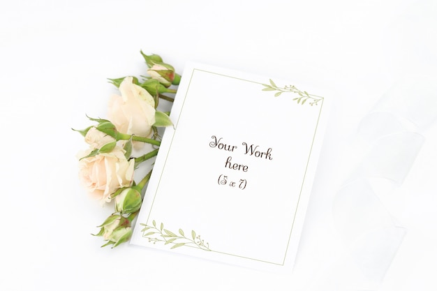 Mockup invitation card with roses and ribbon