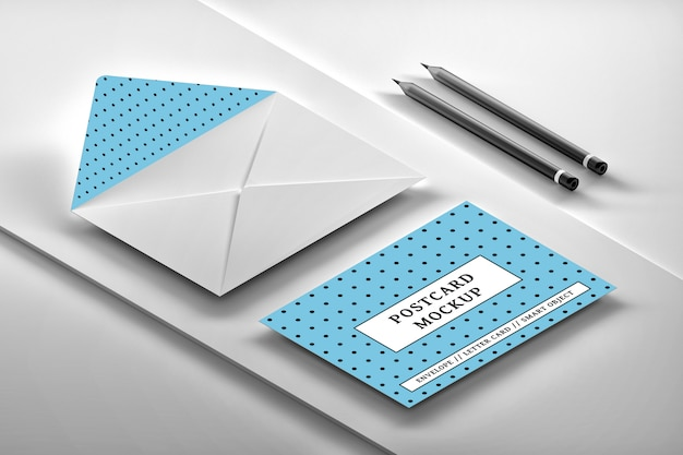 Mockup of isometric arrangement of white opened envelope with message card