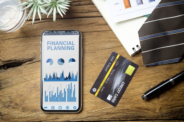 Mockup mobile phone for financial planning background concept.