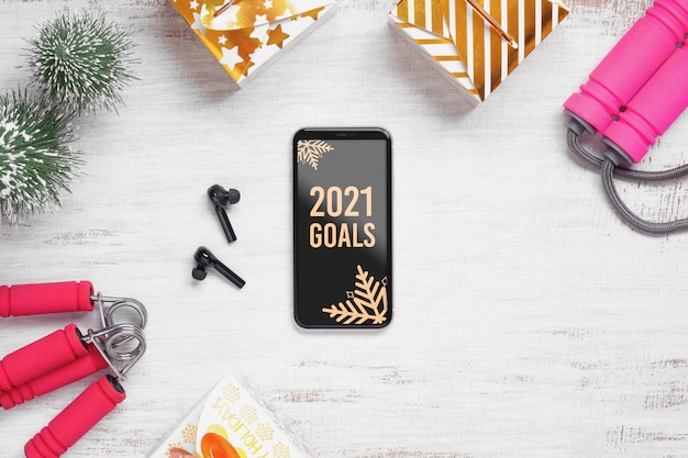 Mockup mobile phone for new year resolutions healthy goals background concept