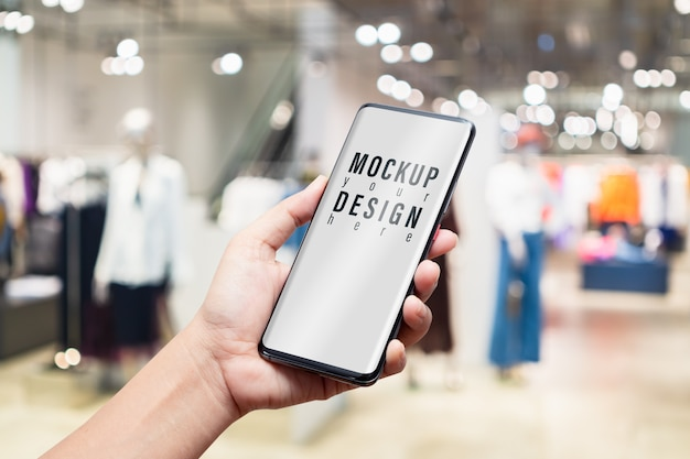 Mockup mobile phone in women clothing fashion shop.