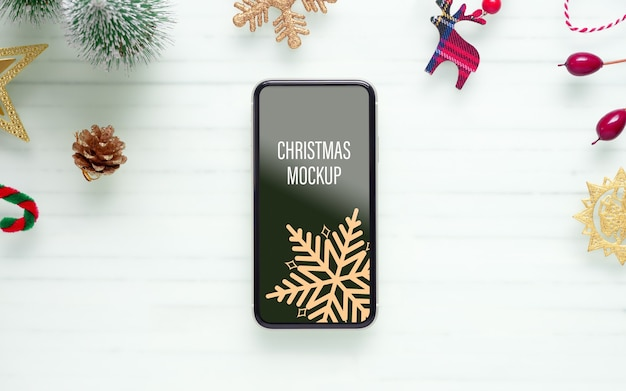 Mockup mobile smart phone for christmas and new year background
