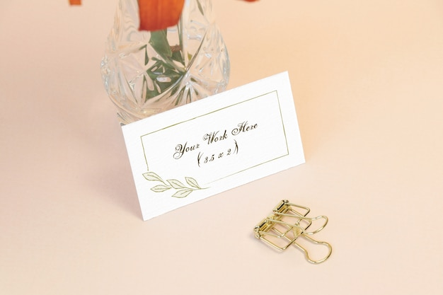 Mockup name card with vase on table