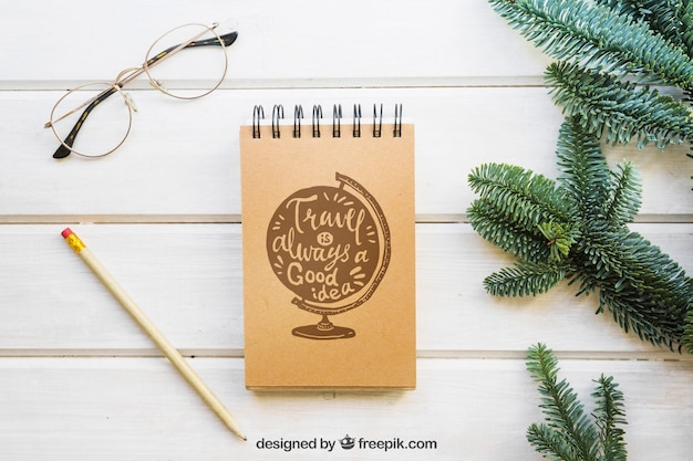 Mockup of notepad next to fir branches