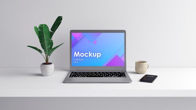 책상과 휴대 전화에 노트북의 모형