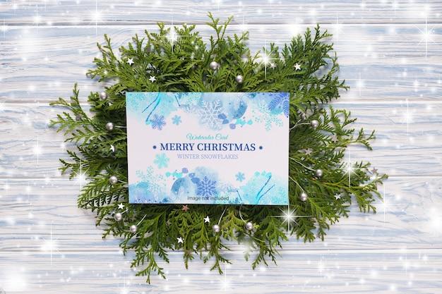 Макет рождественской открытки и еловых веток