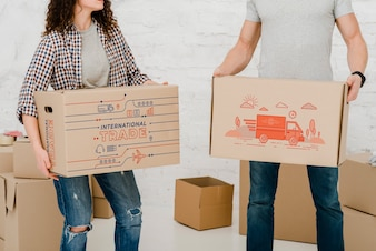 Mockup of couple with cardboard boxes