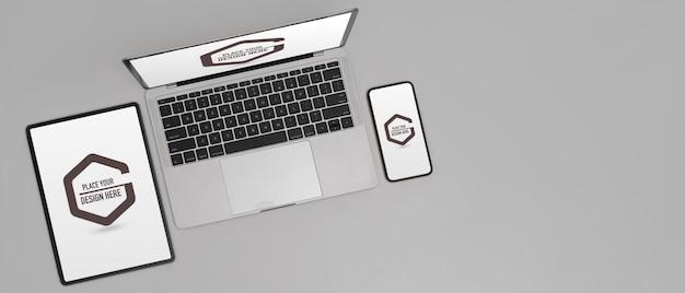 デジタルタブレット、スマートフォン、ラップトップを備えたデジタルデバイスのモックアップ