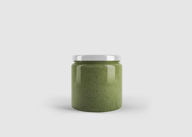 깨끗한 스튜디오 장면에서 사용자 정의 모양 레이블 녹색 잼 또는 소스 또는 페스토 항아리의 모형