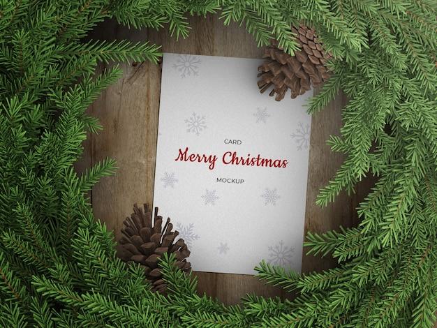 コーンとクリスマスリースの装飾と休日のグリーティングカードチラシのモックアップ