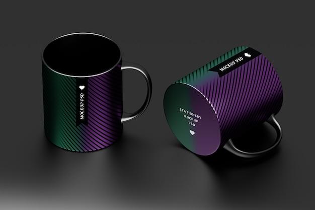 編集可能な表面デザインの2つの黒いマグカップのモックアップ