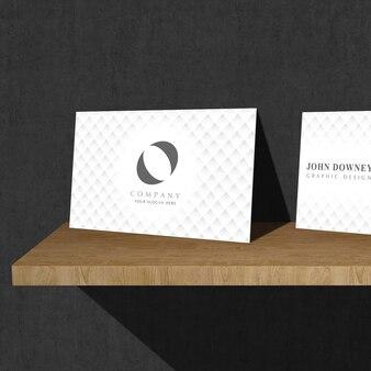 Mockup of white business cards on shelf
