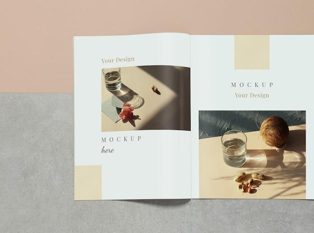 Mockup opened magazine on grey and beige background