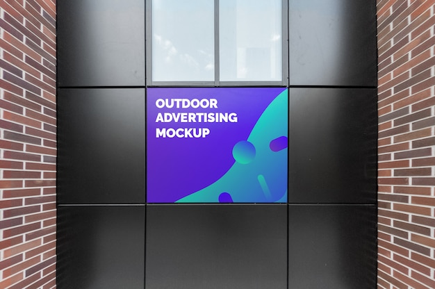 Mockup of outdoor advertising on black facade
