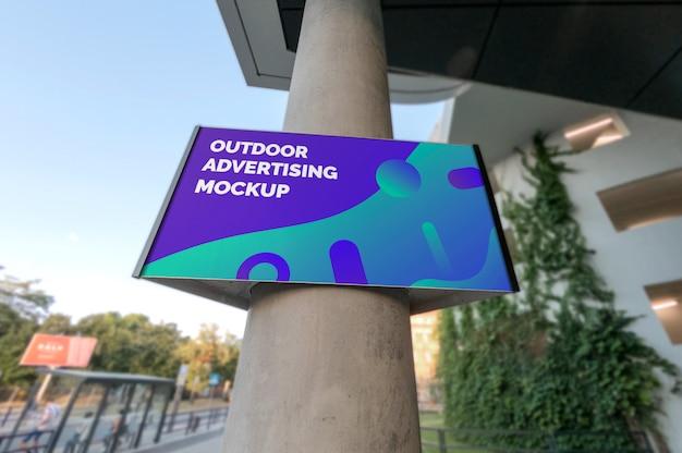 Mockup of outdoor landscape advertising signage hanging on column