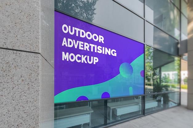 Mockup of outdoor landscape advertising in window frame on modern building