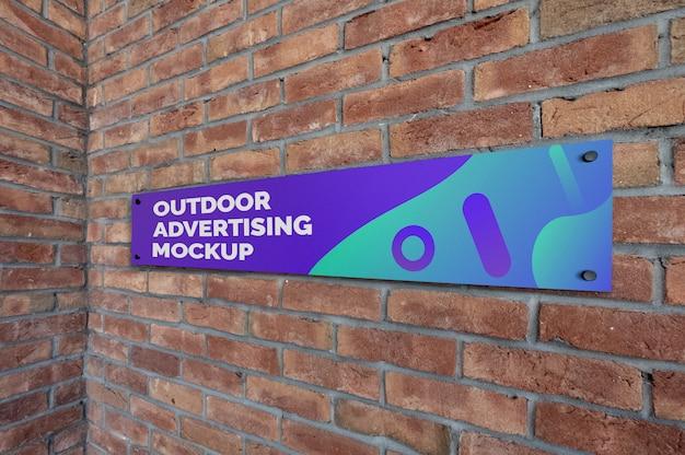 Mockup of outdoor landscape narrow signage on brick wall