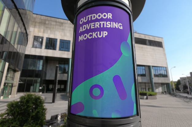 Mockup of outdoor vertical advertising booth on city street pavement