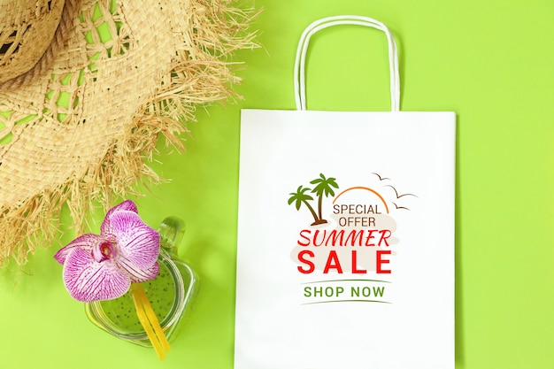 Mockup paper package with straw hat on green background