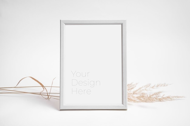 Mockup of photo frame decorated with dried grass