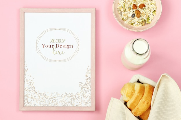 Mockup photo frame on pink background with muesli, croissant and bottle of milk