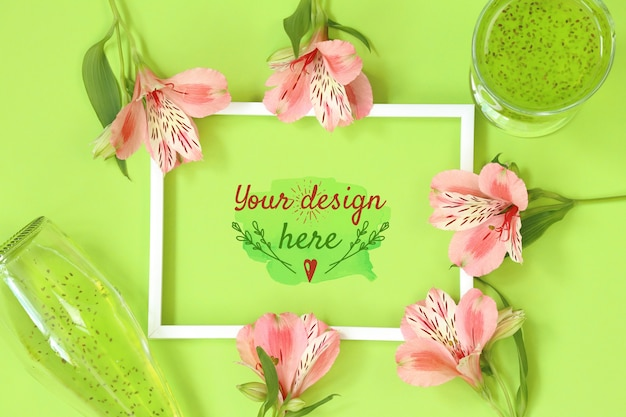 Mockup photo frame with beautiful flowers on green background