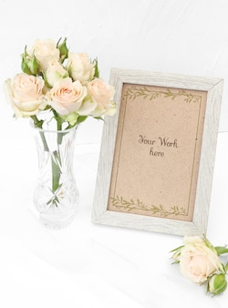 Mockup photo frame with beige roses in vase