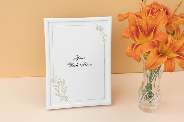 Mockup photo frame with bouquet orange flowers