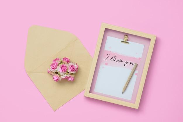 Mockup photo frame with craft rose flower in brown envelope
