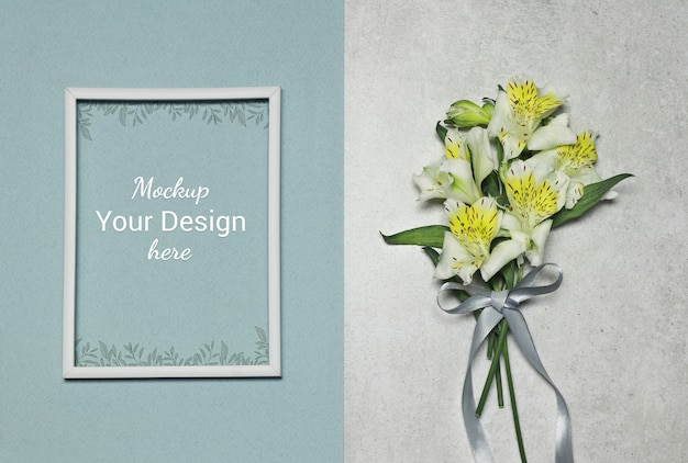 Mockup photo frame with flowers and ribbon on grey blue background
