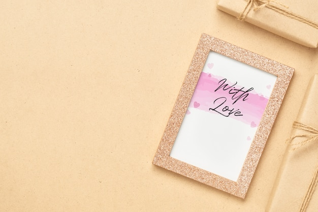 Mockup photo frame with kraft present boxes