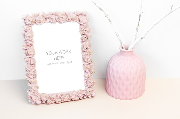 Mockup photo frame with pink rose flower and pink vase