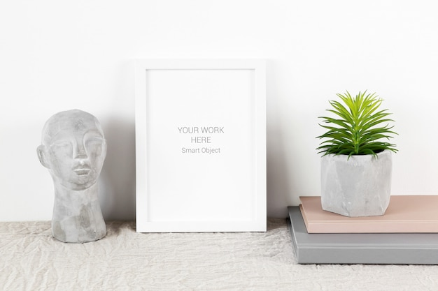 Mockup photo frame with plant and books