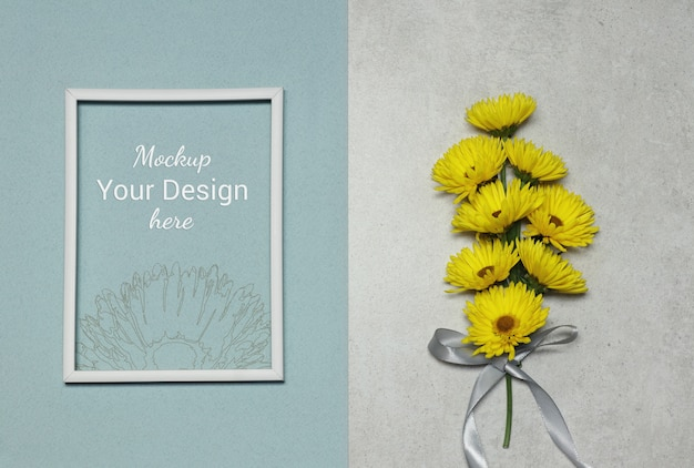 Mockup photo frame with yellow flowers on grey blue background