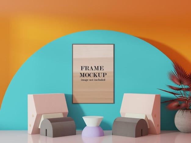 シアンオレンジ色の壁にモックアップ額縁