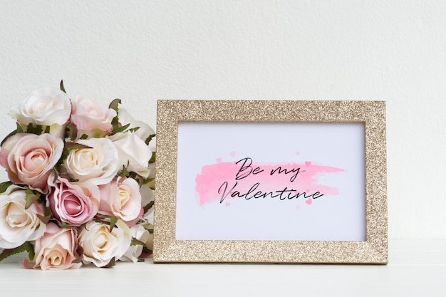 Mockup picture frame and pink roses.