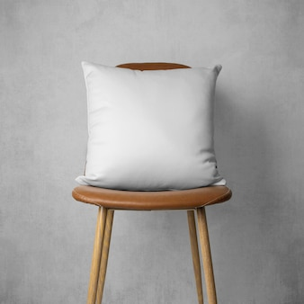 Mockup of pillow on a chair