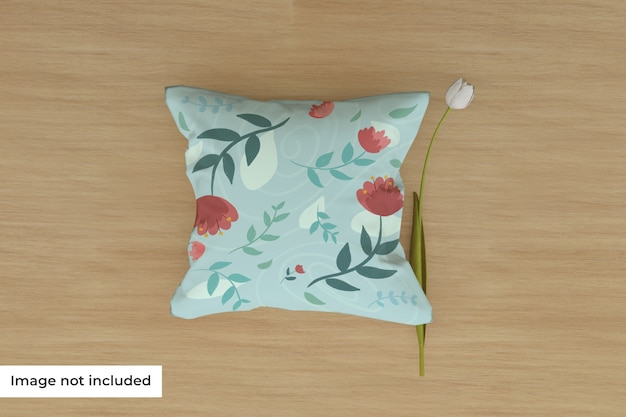 Mockup of pillow on floor with flower