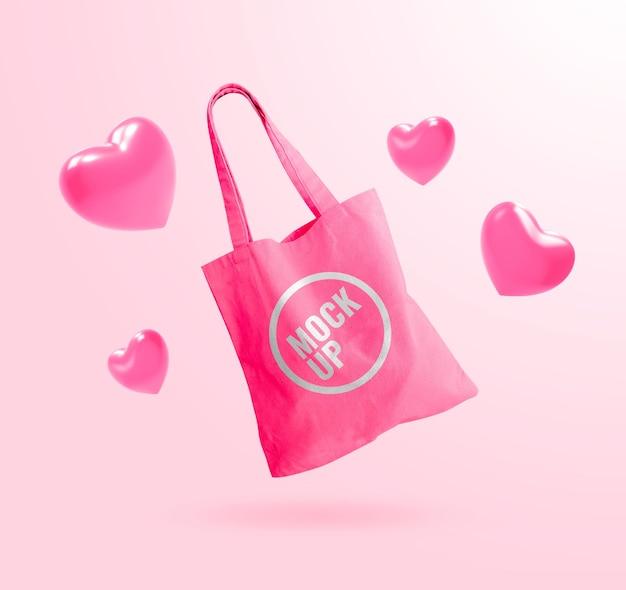 Розовая сумка-тоут mockup с рекламным воздушным шаром в виде сердца
