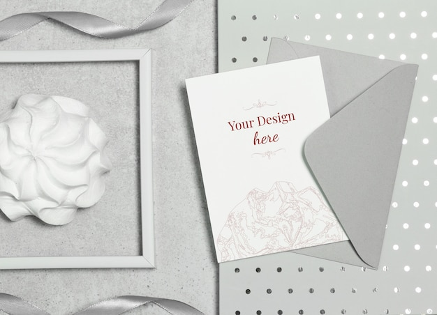 Mockup postcard on grey background with envelope, marshmallow and frame