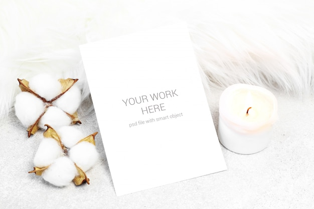 Mockup postcard with candle and cotton