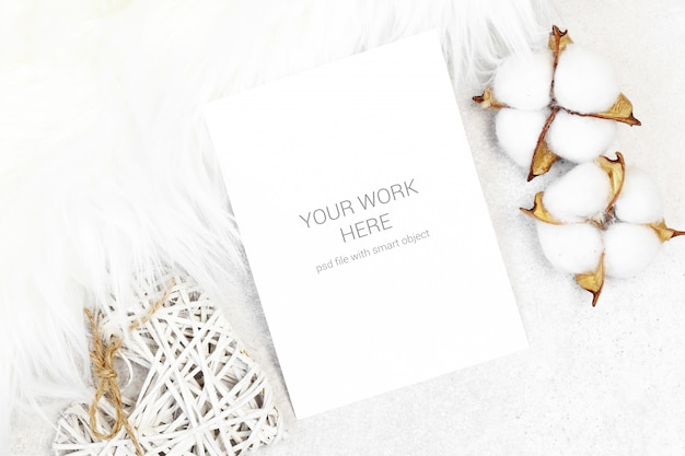 Mockup postcard with cotton and white fur