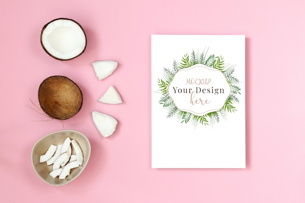 Mockup postcard with piece of coconut on pink background