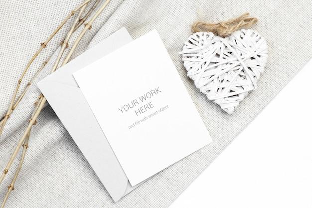 Макет открытки с деревянным сердцем и веткой