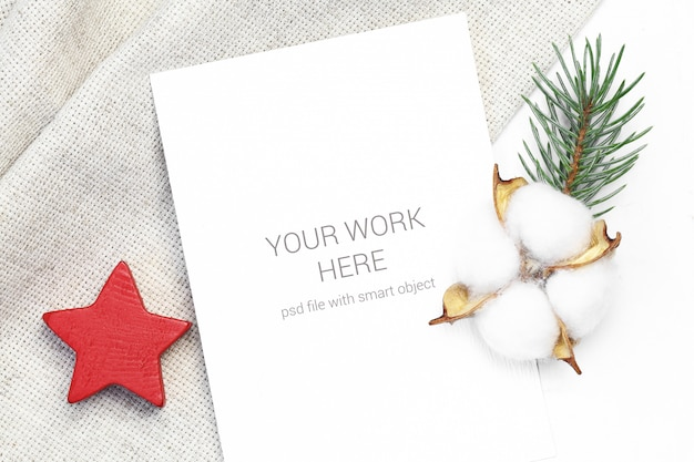 Mockup postcard with wood star and cotton