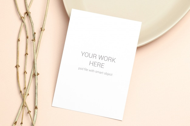 Mockup postcard with wooden branch on beige